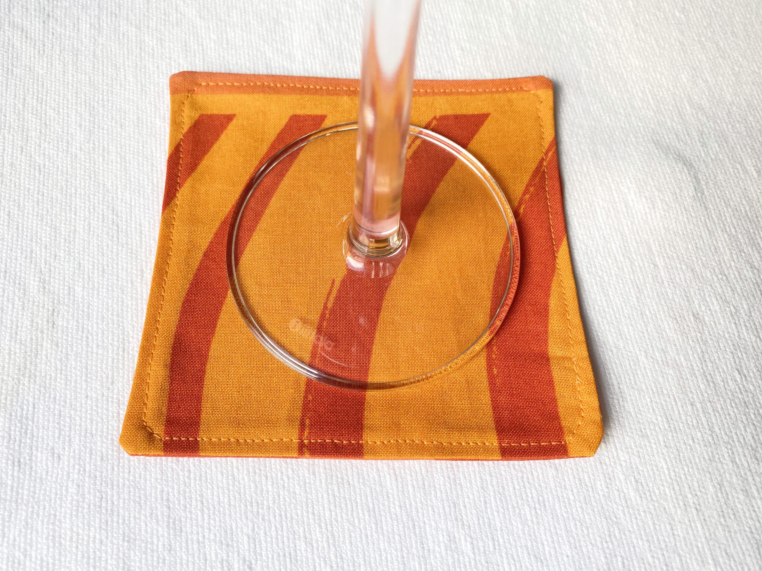 marimekko orange fabric coasters silkkikuikka design