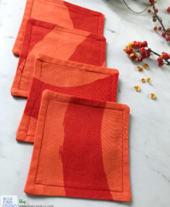 marimekko fabric coasters orange silkkikuikka