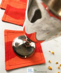 marimekko fabric coasters orange silkkikuikka