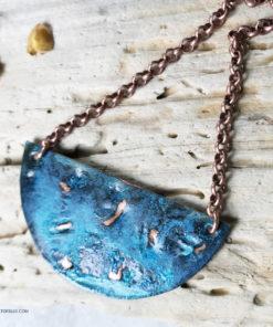 blue patina half moon necklace