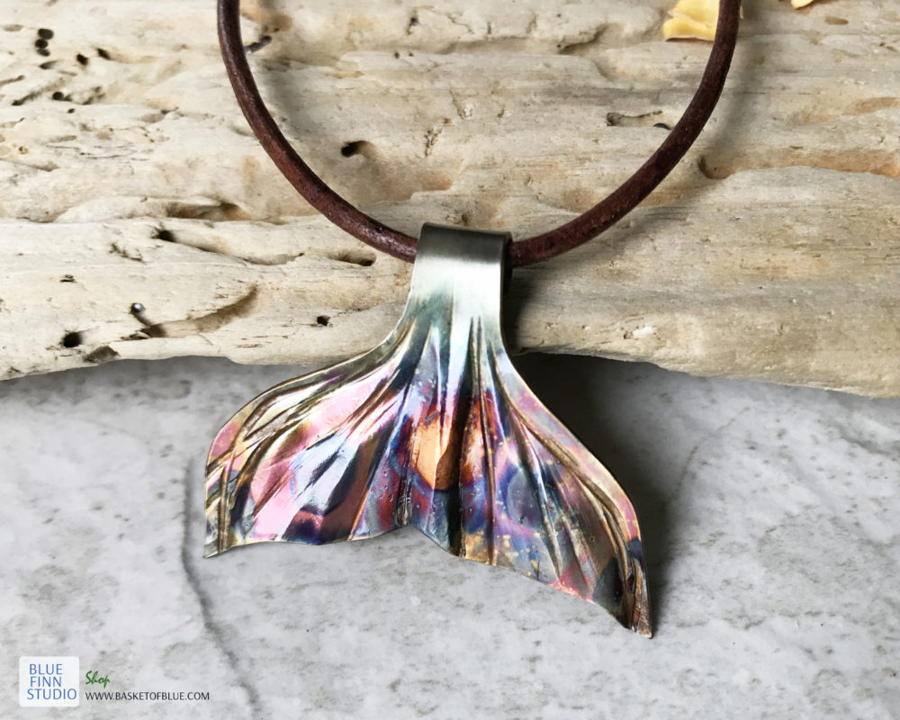 bronze flame painted whale tail necklace