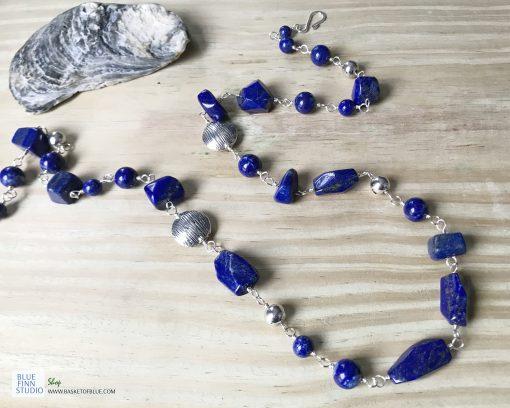 Long blue lapis bead necklace