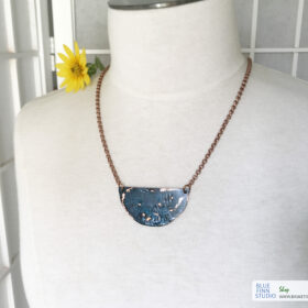 copper patina half moon necklace