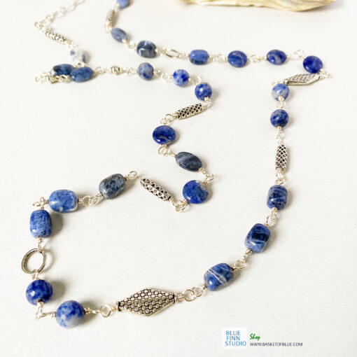 long blue sodalite bead necklace with silver and pewter