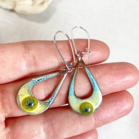the seeing eye enamel teardrop open oval earrings