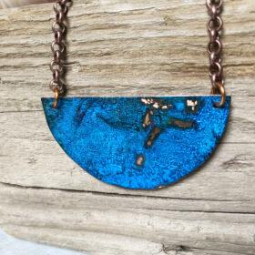 blue copper patina half circle pendant